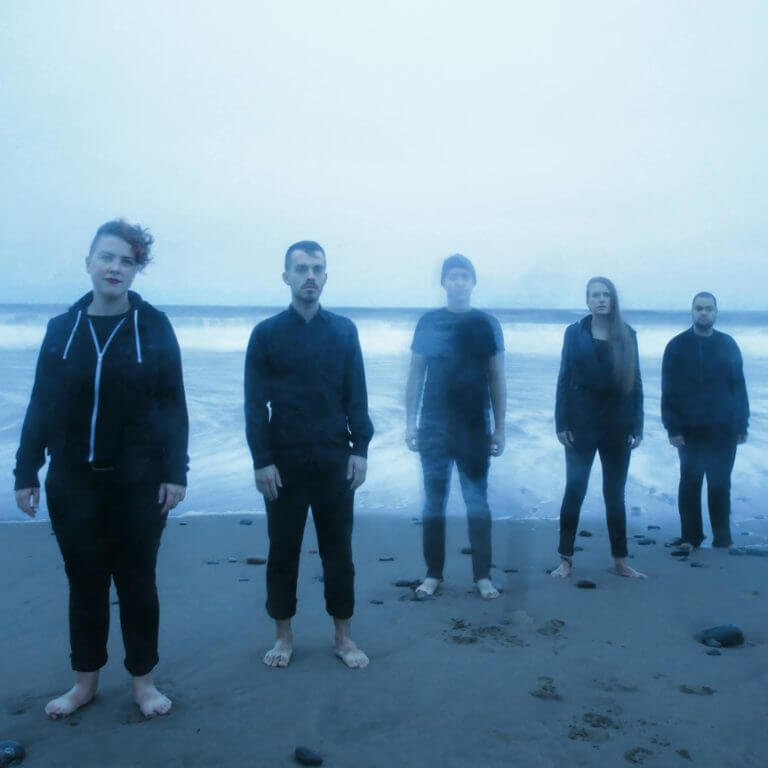 Hillsburn members standing on beach