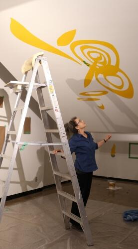 The artist installing her work